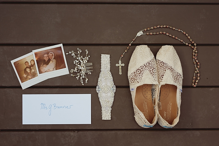 A vignette of Edmonton wedding details including photography by the bride.